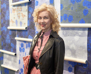 Tiina admiring Birger Kaipiainen's wallpaper designs at the Arabia exhibition, 2015