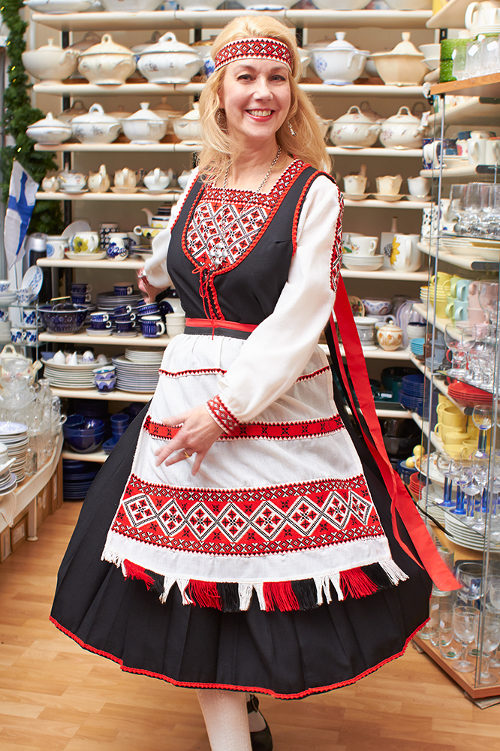 Shopkeeper Tiina in folk costume 2
